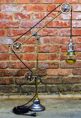 Industrial Pulley Table Lamp - Unique Steampunk/ Industrial lamp. Featuring 3 pulleys, with two-tone color feature of solid brass and antique nickel finish.