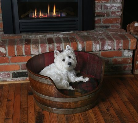 Wine Barrel Pet Bed By Wine Barrel Creations - Let your pooch snuggle up in this smart looking upcycled wine barrel, complete with fitted pillow