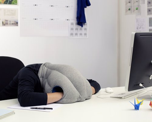 Ostrich Pillow - Nap Anywhere - Block out the outside world and catch a comfortable nap anywhere, any time
