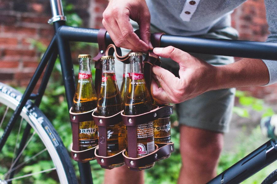 Leather Bicycle Six Pack Caddy - No need for bags or dangerous hand-carrying of your beers, with this handy six-pack bicycle beer caddy