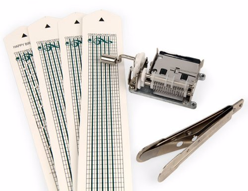 Make Your Own Music Box Kit - Punch holes in the paper strips to create your own music box melody