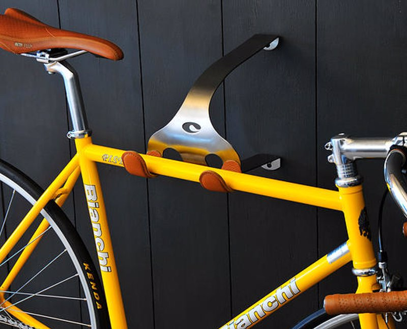 Beautiful Bike Hangers By Cactus Tongue - Hang your bike on the wall in style. By the crossbar or handlebars, inside or out